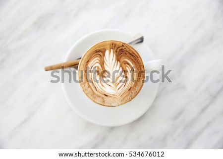 cappuccino coffee on wood background