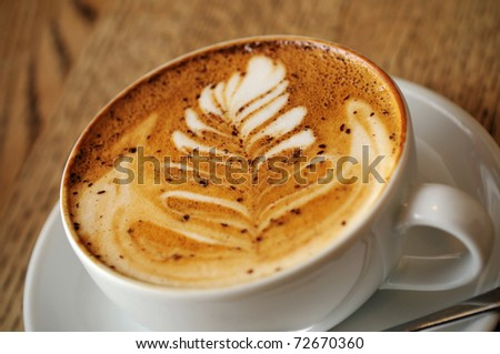 cappuccino cup on the brown wooden table - stock photo