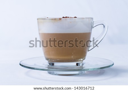 Cappuccino in a cup on white background - stock photo