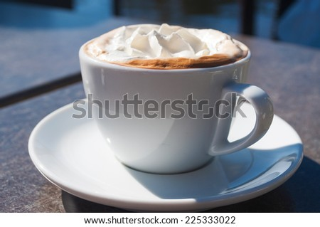 Cappuccino on the wooden table - stock photo
