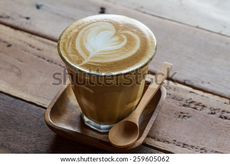 Cappuccino or latte coffee at the coffee shop. - stock photo