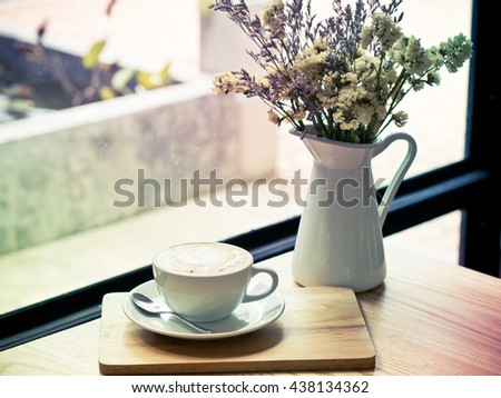Cappuccino or latte coffee at the coffee shop.Cappuccino in the window light - stock photo