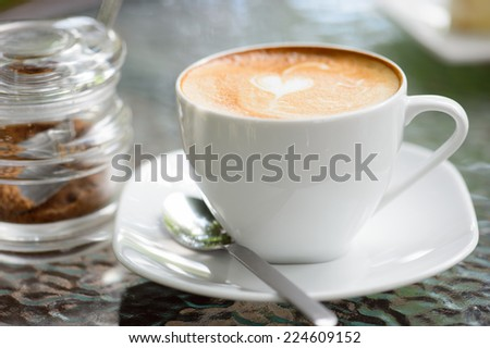 Cappuccino or latte coffee with heart shape - stock photo