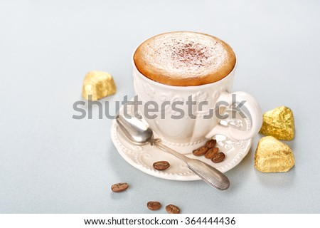 Cappuccino with chocolate candies and spices. Shallow DOF - stock photo
