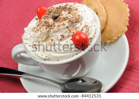 Cappuccino  with cream and chocolate flakes - stock photo