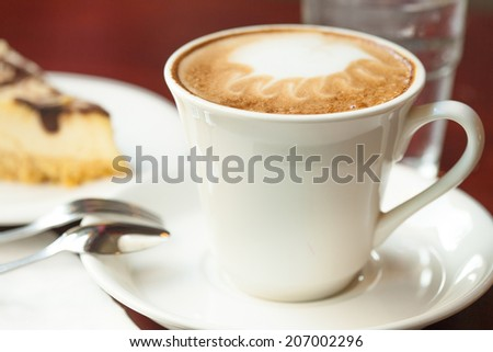 cappucino cup with cheese cake - stock photo
