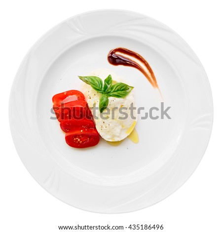 Caprese appetizer on plate, isolated on white background - stock photo