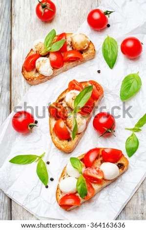 Caprese bruschetta on a white wod background. toning. selective Focus