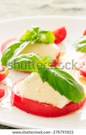 Caprese made by tofu and tomato - stock photo