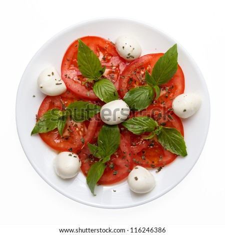 caprese salad on plate directly above isolated on white background - stock photo