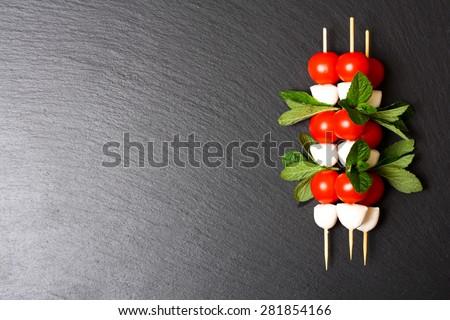 Caprese salad on sticks - stock photo