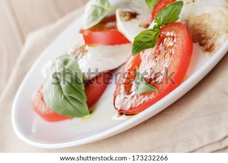 caprese salad with balsamic made on white plate