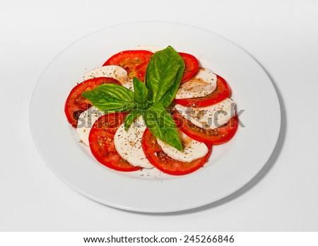 Caprese salad with mozarella, tomatoes, basil and balsamic sauce. Top view  - stock photo