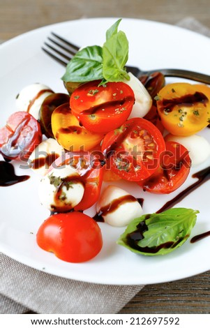 caprese salad with wine sauce, food closeup