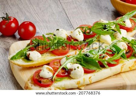 Caprese sandwiches of mozzarella cheese, tomato and basil - stock photo