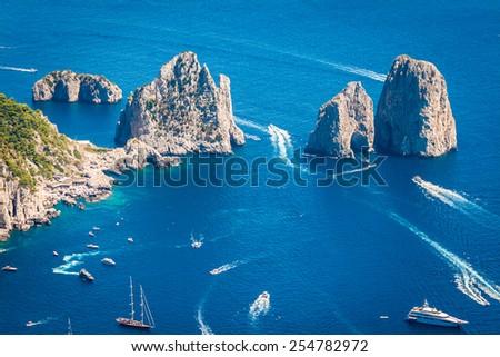 Capri, beautiful and famous island in the Mediterranean Sea Coast, Naples. Italy. Scenics of Faraglioni and seascape from Anacapri, aerial point of view.  - stock photo