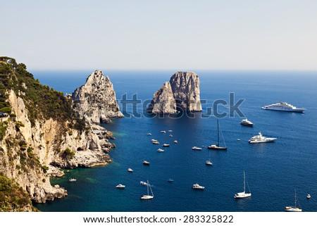 Capri Faraglioni. Stacks rising out of the sea. Capri, Italy. - stock photo