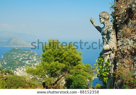 Capri island and statue pointing - stock photo