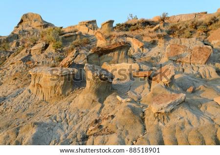 caprocks on badlands - stock photo