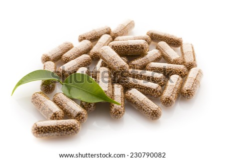 Capsule with a homeopathic granule contents. - stock photo