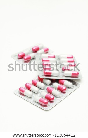 Capsules and pills packed in blisters. - stock photo
