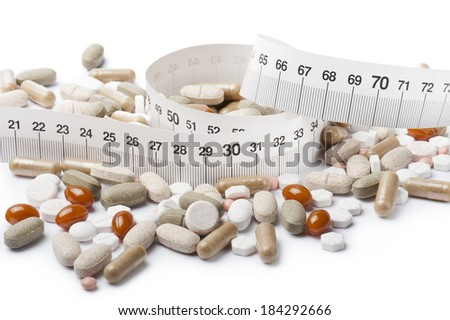 capsules for diet with pills, tablets and meter on white background - stock photo