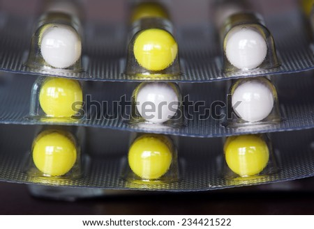 Capsules in a blister pack macro photo - stock photo