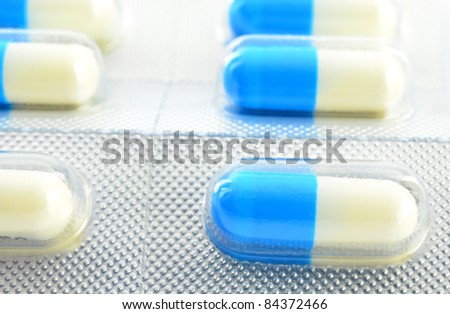 capsules in blister packs on white background