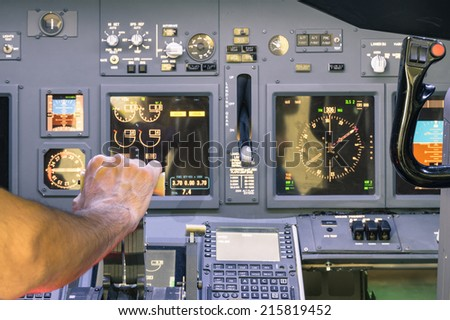 Captain hand accelerating on the throttle in commercial airliner flight simulator - Cockpit thrust levers on the phase of takeoff - stock photo