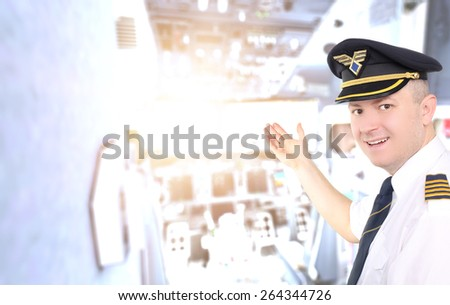 Captain invites you into the cockpit of an airplane - stock photo