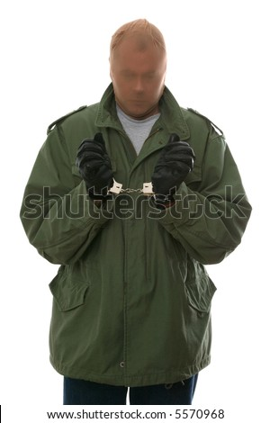 Captured bank robber in handcuffs. Isolated on white.
