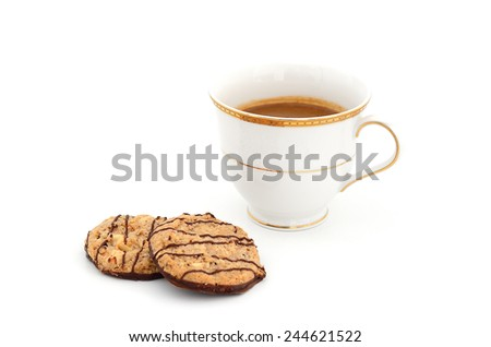 capuccino coffee in vintage style cup and chocolate almond cookie isolate white background - stock photo