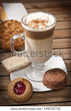 Capuchino coffe and cookies - stock photo