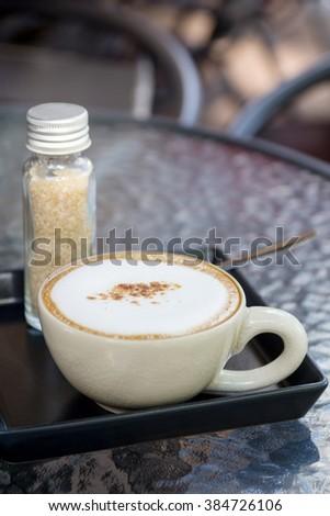 capuchino coffee with sugar - stock photo