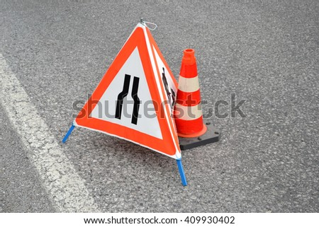 Car accident concept - triangle and traffic cone - stock photo