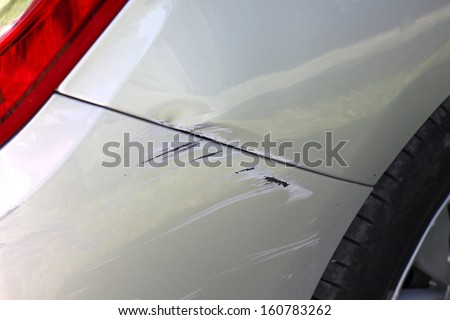 Car accident, damaged vehicle after crash - stock photo