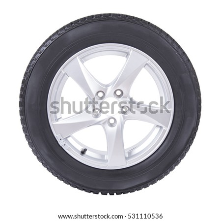 Car alloy wheel with black rubber winter tire, isolated on white background