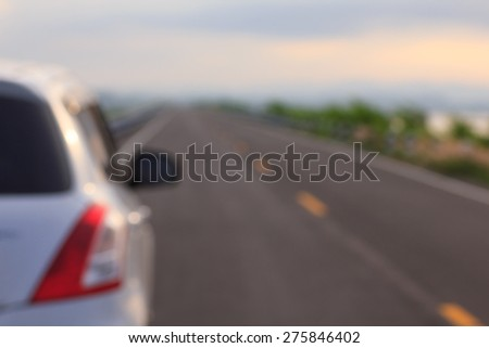 car and rear view mirror on the road - stock photo