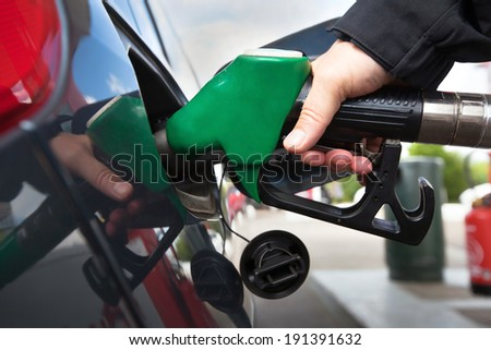 car at gas station - stock photo