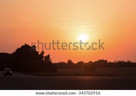 Car at sunset. - stock photo