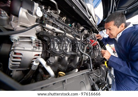 Car at the mechanic for problems with engine - stock photo