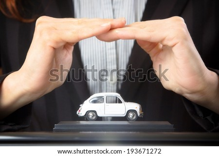 Car (automobile) insurance and collision damage waiver concepts. Businesswoman with protective gesture. - stock photo