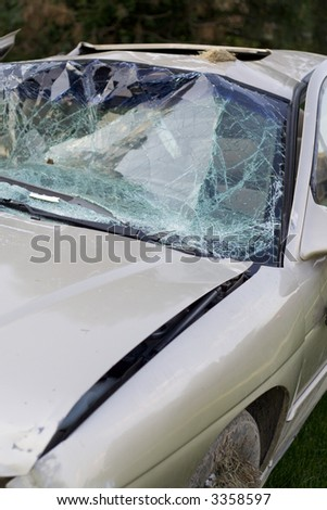 Car badly damaged in an accident with a drunk driver - stock photo