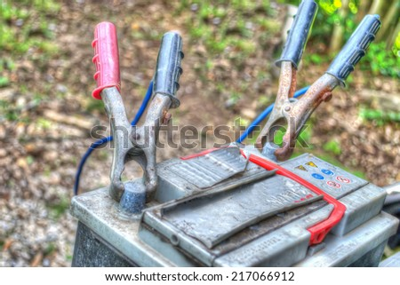 car battery with cables in hdr tone mapping - stock photo