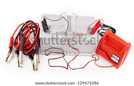 Car battery with two jumper cables clipped to the terminals isolated on white