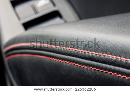 car black leather seat with red stitch - stock photo