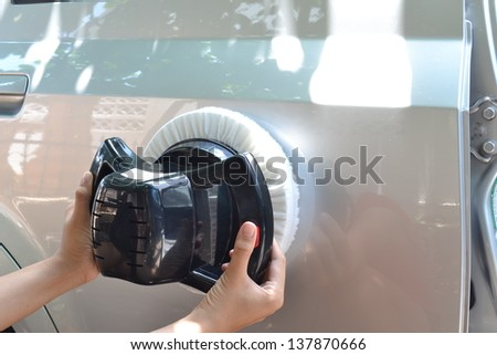 Car care with buffer machine at service- a series of CAR CARE images - stock photo