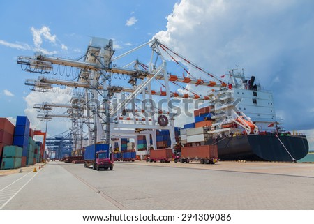 car carrying containers on cargo ships. - stock photo