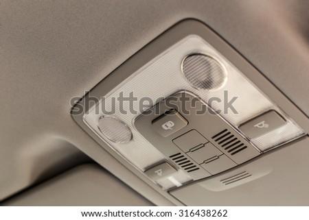 Car ceiling lamp, interior's details - stock photo