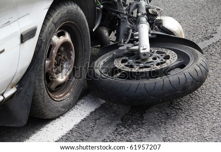 Car collided with a motorbike. - stock photo